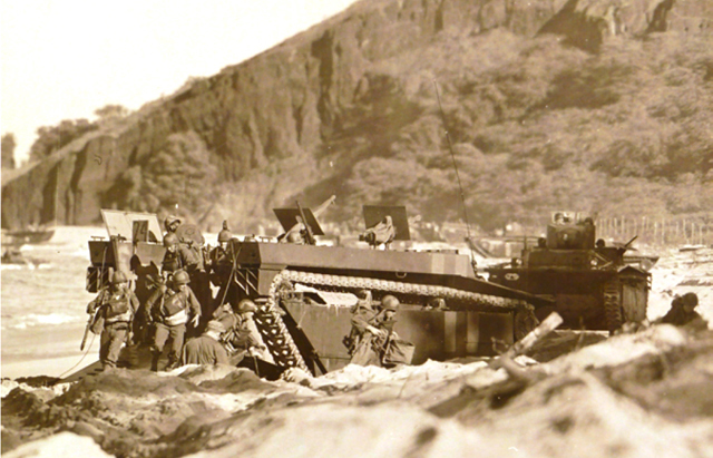 Amphibious Tractors or Landing Vehicle Tracked (LVTs) on Makena Beach, Maui, 1945. Some of these became some of our Maui wreck dives.